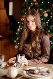 Beautiful young woman setting the Chrtismas table Royalty Free Stock Photos