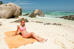 Beautiful young woman in Seychelles tropical beach. Royalty Free Stock Photos