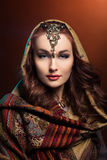 Beautiful young woman in shawl Royalty Free Stock Photography
