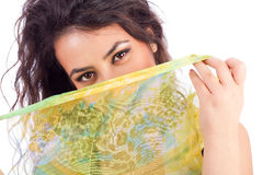 Beautiful young woman with a shawl partially covering her face. On white background Royalty Free Stock Image