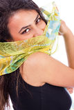 Beautiful young woman with a shawl partially covering her face. On white background Stock Photography