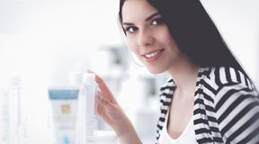 Beautiful young woman in shop Stock Photography