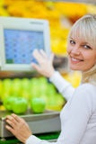 Beautiful young woman shopping. For fruits and vegetables in produce departmant of a grocery store/supermarket (shallow DOF Stock Photos