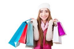 Beautiful young woman with shopping bags. Stock Photos