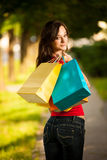 Beautiful young woman with shopping bags in the city Royalty Free Stock Photography