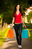Beautiful young woman with shopping bags in the city Royalty Free Stock Photo