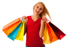 Beautiful young woman with shopping bags consumerism  ov. Er white backgeeound Stock Images