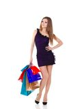 Beautiful young woman with shopping bags and gifts. Woman with shopping bags and gifts isolated stock image
