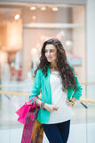 Beautiful young woman with shopping bags and gifts. Royalty Free Stock Photo