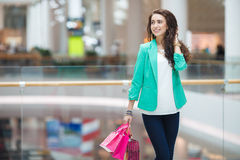 Beautiful young woman with shopping bags and gifts. Stock Photography