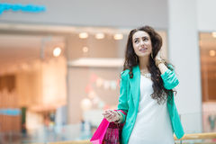 Beautiful young woman with shopping bags and gifts. Stock Images
