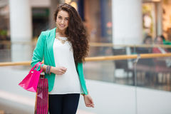 Beautiful young woman with shopping bags and gifts. Royalty Free Stock Photography