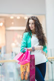 Beautiful young woman with shopping bags and gifts. Stock Image