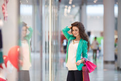 Beautiful young woman with shopping bags and gifts. Royalty Free Stock Image