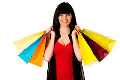 Beautiful young woman with shopping bags isolated Stock Photos