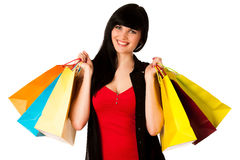 Beautiful young woman with shopping bags isolated Royalty Free Stock Photos