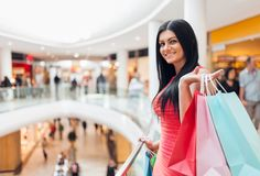 Beautiful woman with shopping bags at the mall Royalty Free Stock Photo