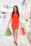 Beautiful woman with shopping bags at the mall Royalty Free Stock Photos