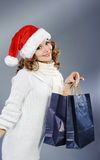 Beautiful young woman with shopping bags Royalty Free Stock Image
