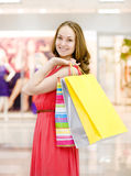 Beautiful young woman with shopping bags Stock Photos