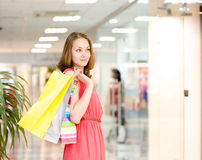 Beautiful young woman with shopping bags in a supermarket Royalty Free Stock Photography