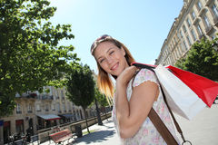 Beautiful young woman with shopping bags Royalty Free Stock Images