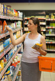 Beautiful young woman shopping for cereal, bulk in a grocery sto Royalty Free Stock Images
