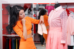 Beautiful young woman shopping in a clothing store Royalty Free Stock Image