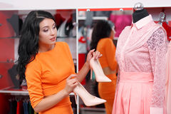 Beautiful young woman shopping in a clothing store Royalty Free Stock Photography