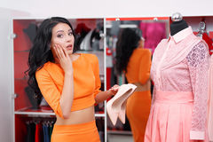 Beautiful young woman shopping in a clothing store Stock Photography