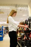 Beautiful young woman shopping dishes for her new home royalty free stock photo