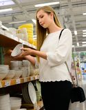 Beautiful young woman shopping dishes for her new home stock photos
