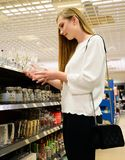 Beautiful young woman shopping dishes for her new home royalty free stock images