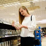 Beautiful young woman shopping dishes for her new home stock image