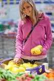 Beautiful young woman shopping for fruits Royalty Free Stock Image