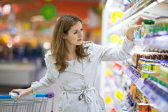 Beautiful young woman shopping for fruits and vegetables Stock Photos