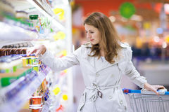 Beautiful young woman shopping for fruits and vegetables Stock Photo