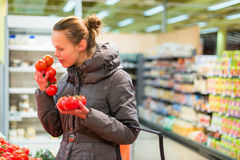 Beautiful, young woman shopping for fruits and vegetables in pro Stock Photos