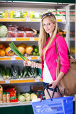 Beautiful young woman shopping for fruits and vegetables Royalty Free Stock Photos
