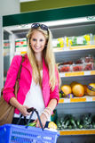 Beautiful young woman shopping for fruits and vegetables Royalty Free Stock Photography