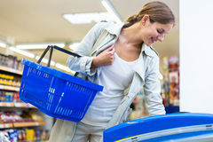 Beautiful young woman shopping in a grocery store/supermarket Royalty Free Stock Photo