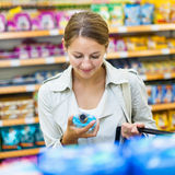 Beautiful young woman shopping in a grocery store/supermarket Stock Photo