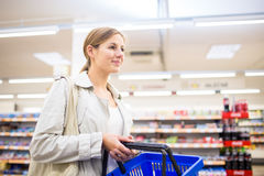 Beautiful young woman shopping in a grocery store Stock Image