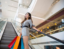 Beautiful young woman shopping in mall Royalty Free Stock Images
