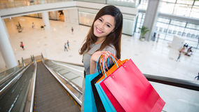 Beautiful young woman shopping in mall Stock Images