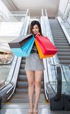Beautiful young woman shopping in mall Royalty Free Stock Image
