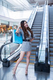 Beautiful young woman shopping in mall Royalty Free Stock Photo