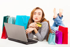 Beautiful young woman shopping over internet Royalty Free Stock Photo