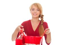 Beautiful young woman with a shopping package Royalty Free Stock Photography
