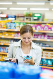 Beautiful young woman shopping in a supermarket Royalty Free Stock Image